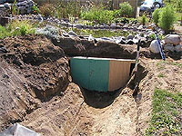 How to build a garden stream discharge and pond overflow for Garden pond overflow design
