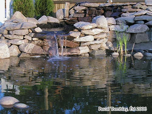 Build rock waterfall how to build flagstone waterfall for Building a fountain pond